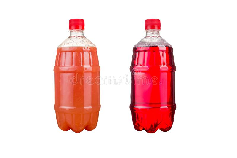 Two plastic bottles with colorful natural juices. Isolated royalty free stock photos