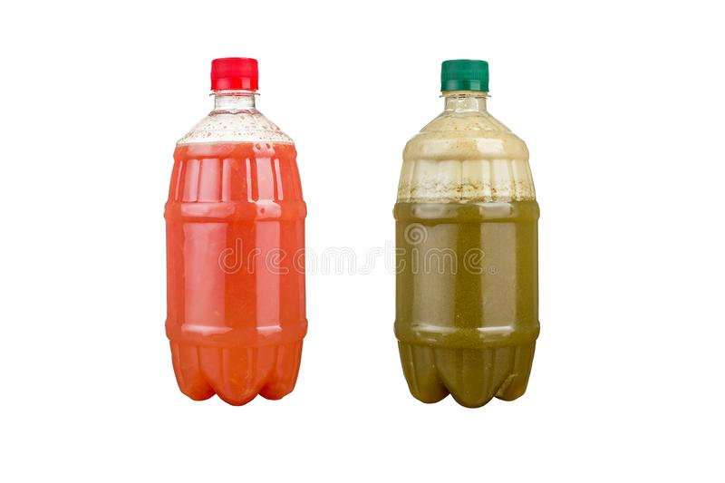 Two plastic bottles with colorful natural juices. Isolated stock images