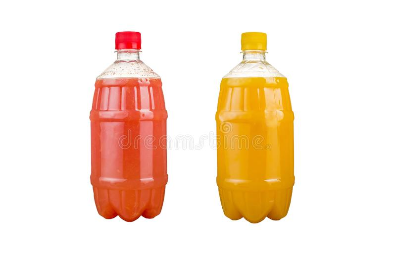 Two plastic bottles with colorful natural juices. Isolated royalty free stock photography