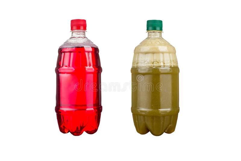 Two plastic bottles with colorful natural juices. Isolated stock photo