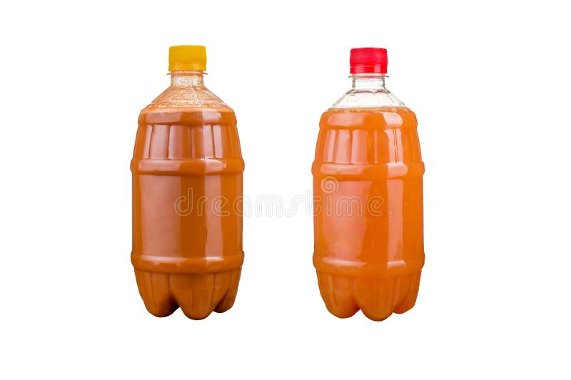 Two plastic bottles with colorful natural juices. Isolated royalty free stock image