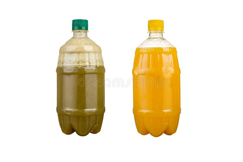Two plastic bottles with colorful natural juices. Isolated stock photography