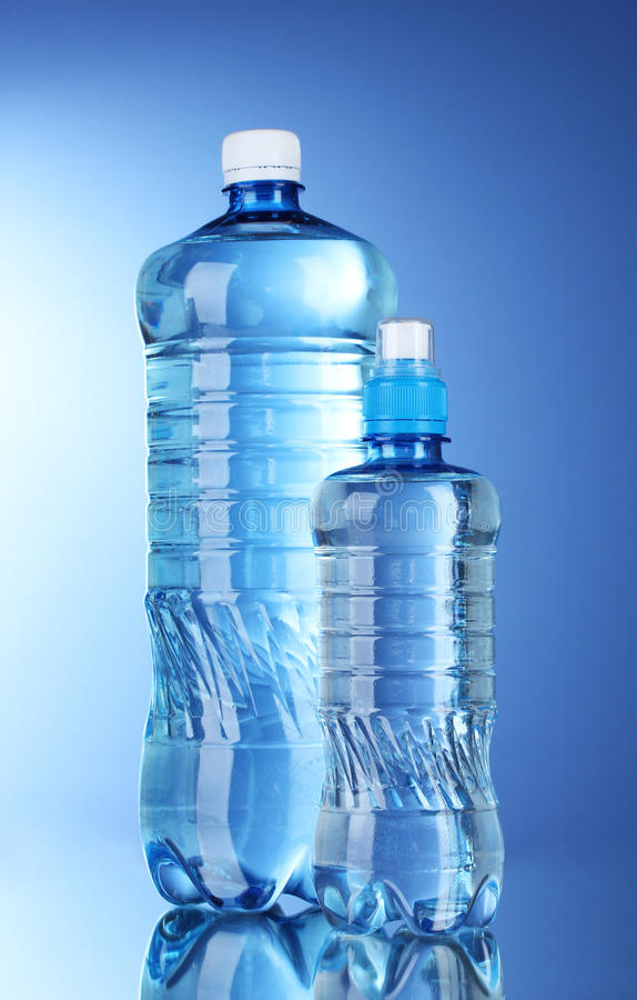 Two plastic bottles of water royalty free stock photos