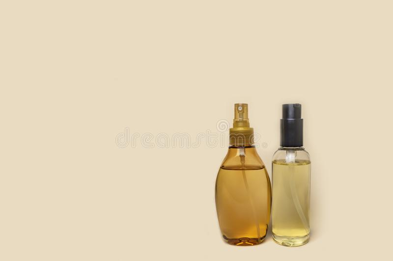 Two plastic bottles with yellow massage oil stock photography