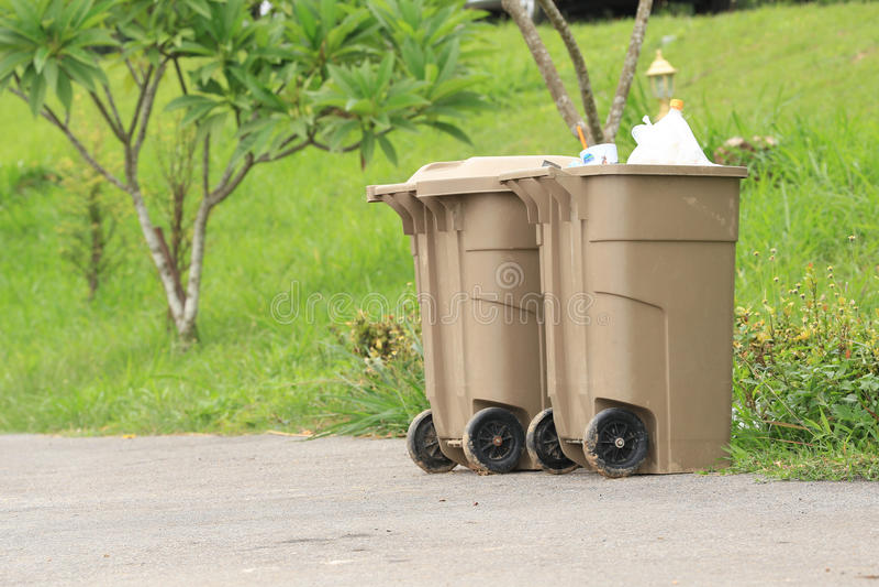 Two plastic dust bin stock image