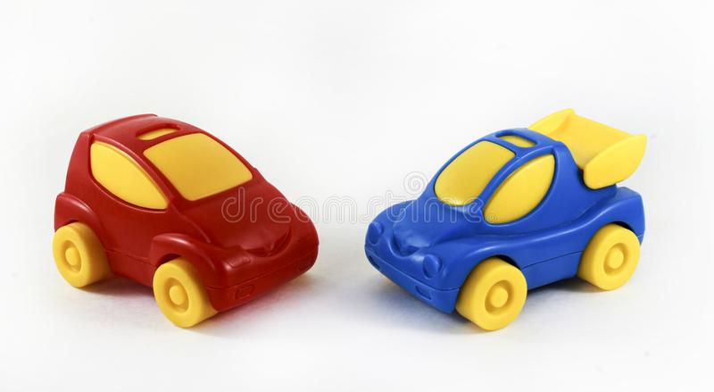 Two plastic machines together, opposite each other, blue and red stock image