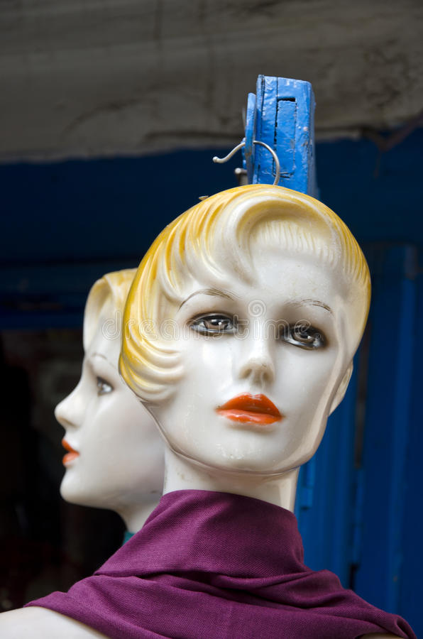 Two plastic mannequin head in asia street, Kathmandu royalty free stock photo