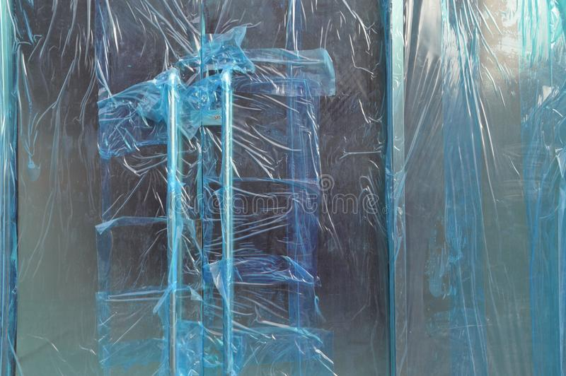 In plastic sealed glass doors of a new shop stock images