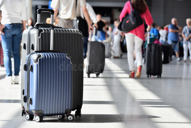 Two plastic travel suitcases in the airport hall.  stock photos