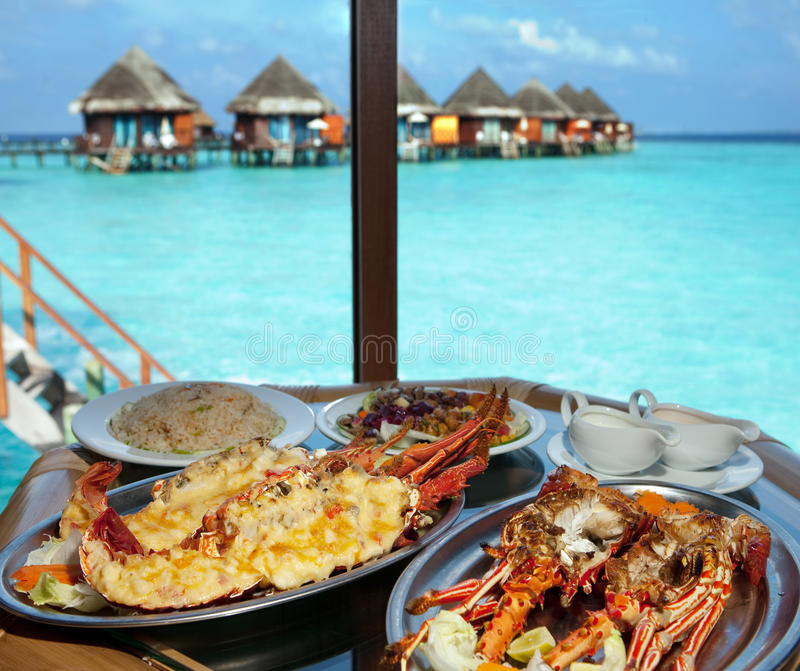 Two plates with lobster on table royalty free stock image