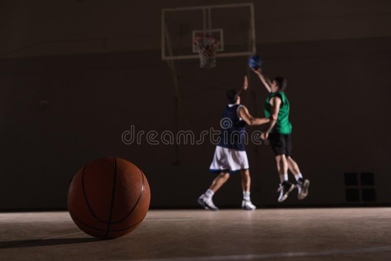 Two players playing basketball stock photography