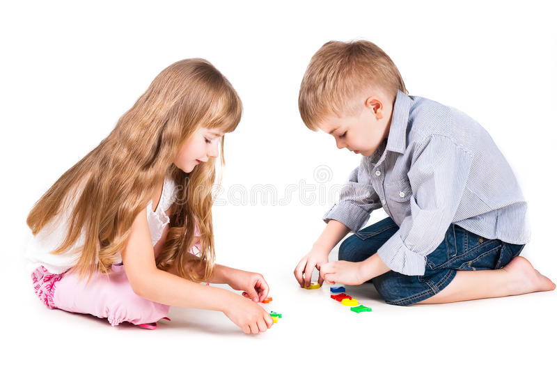 Two playing kids with alphabet isolated on white stock image