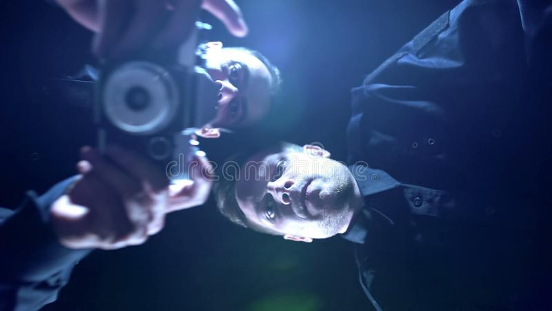 Two policemen taking photos of evidence and corpse on crime scene, investigation. Stock photo royalty free stock photos