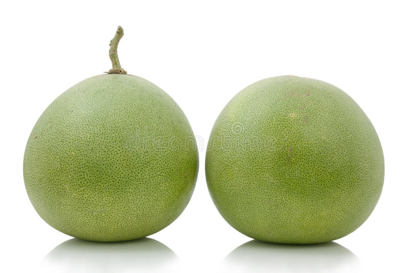 Two pomelo fruit. royalty free stock photography