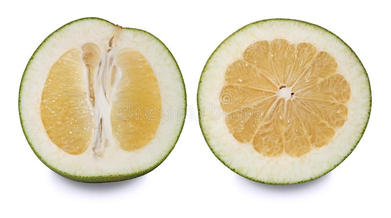 Two pomelos cut in half. stock photography