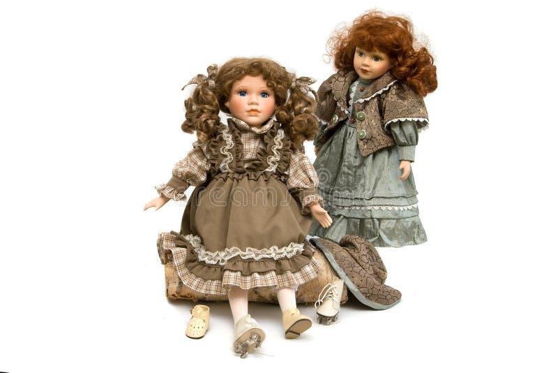 Two porcelian dolls with skates royalty free stock photos