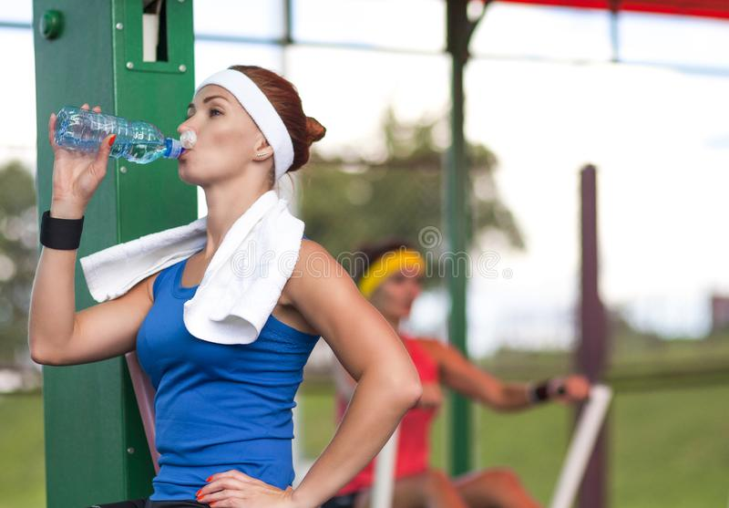 Two positive caucasian female athlete in good fit stock photography