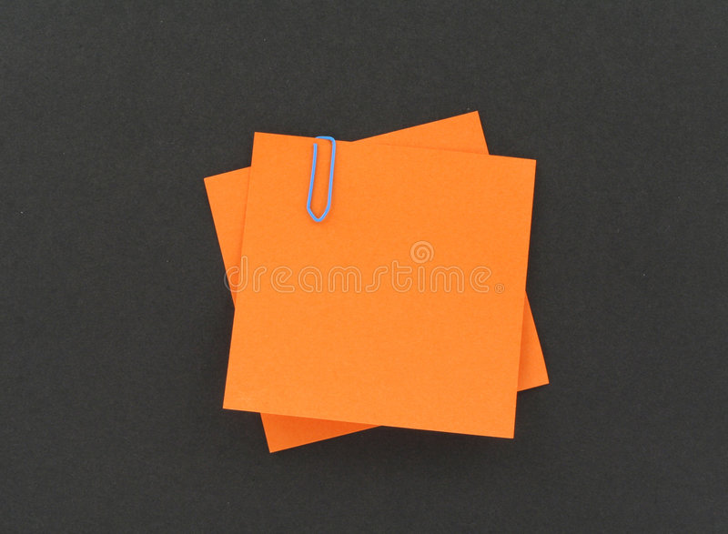 Two post-it notes with a paperclip stock photos