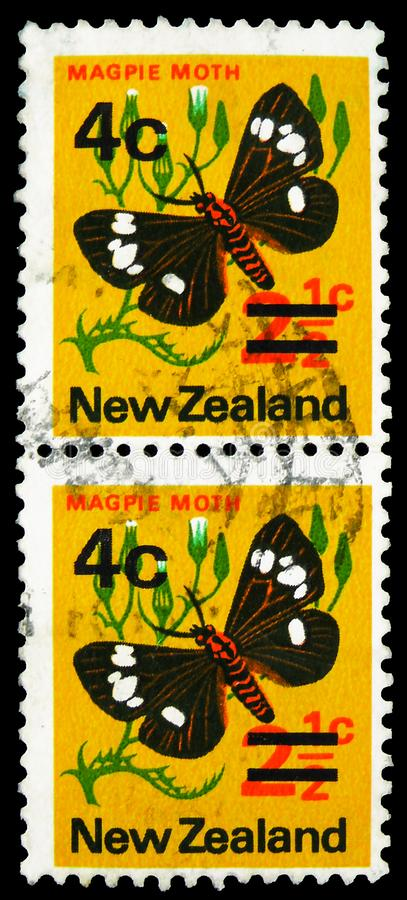 Two postage stamp printed in New Zealand shows Magpie Moth (Nyctemera annulata), overprint, Pictorial Definitives serie, circa. MOSCOW, RUSSIA - SEPTEMBER 22 stock photos