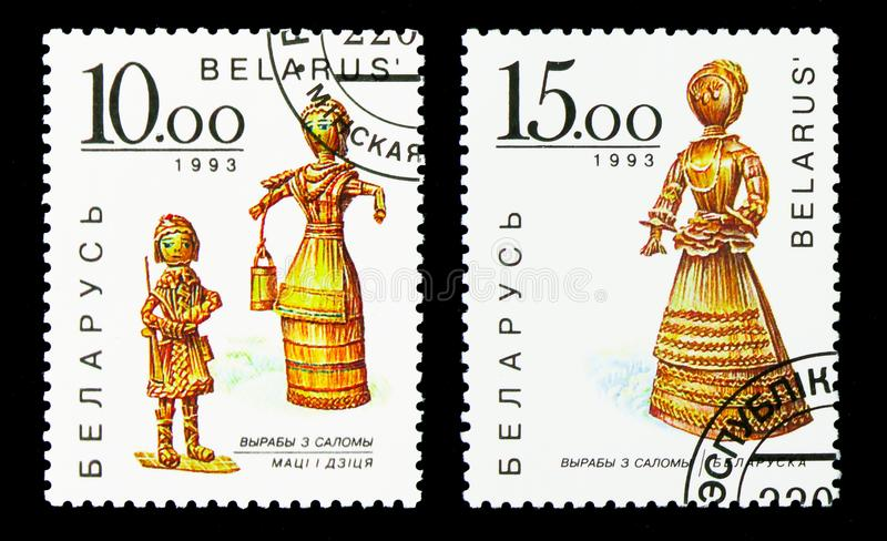 Two postage stamps printed in Belarus from the Straw Figures serie, circa 1993. MOSCOW, RUSSIA - NOVEMBER 26, 2017: Two postage stamps printed in Belarus from royalty free stock photos