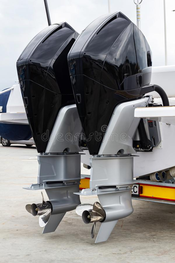 Two powerfull boat engines. Two powerfull outboard engines on land royalty free stock images