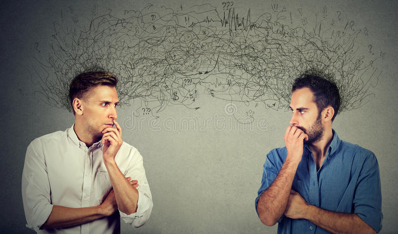 Two preoccupied men looking at each other exchanging thoughts stock image