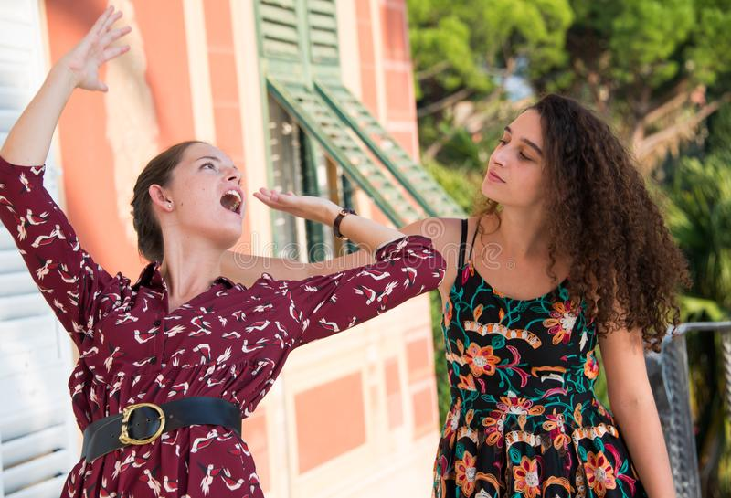 Two pretty girls are fighting and pulling their hair stock photos