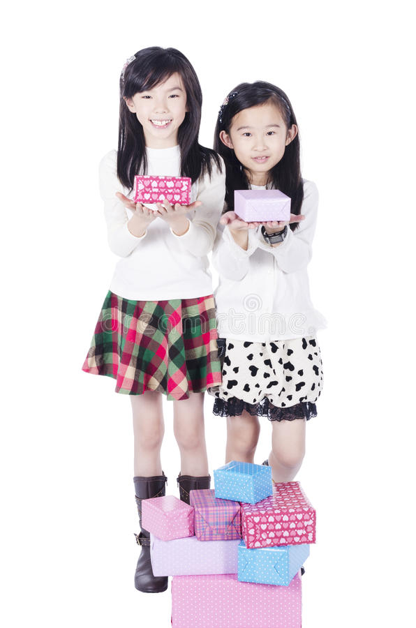 Two pretty girls get gifts stock image