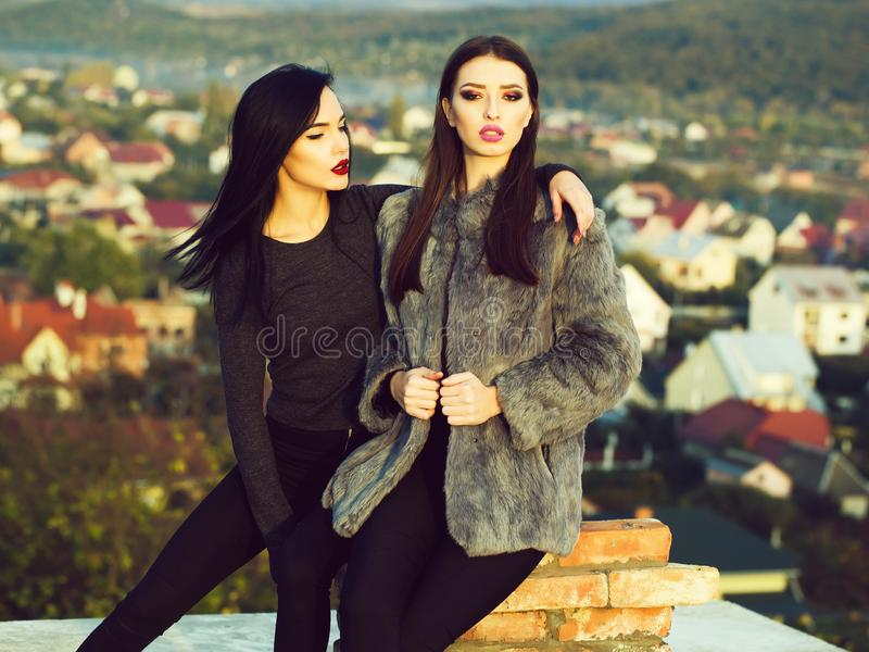 Two pretty girls on roof royalty free stock images