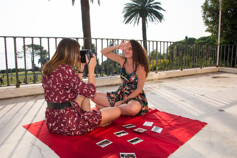 Two pretty girls are taking photos for social media. royalty free stock photography