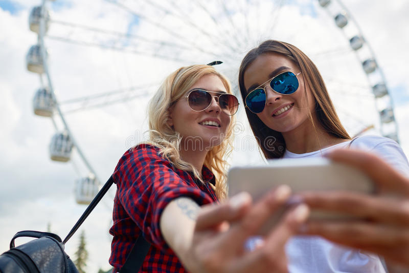 Two Pretty Girls Taking Selfie stock images