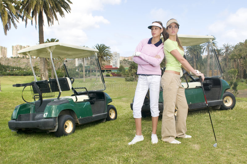 Download Two Pretty Golf Player With Her Golf Cars Stock Image - Image: 8662685