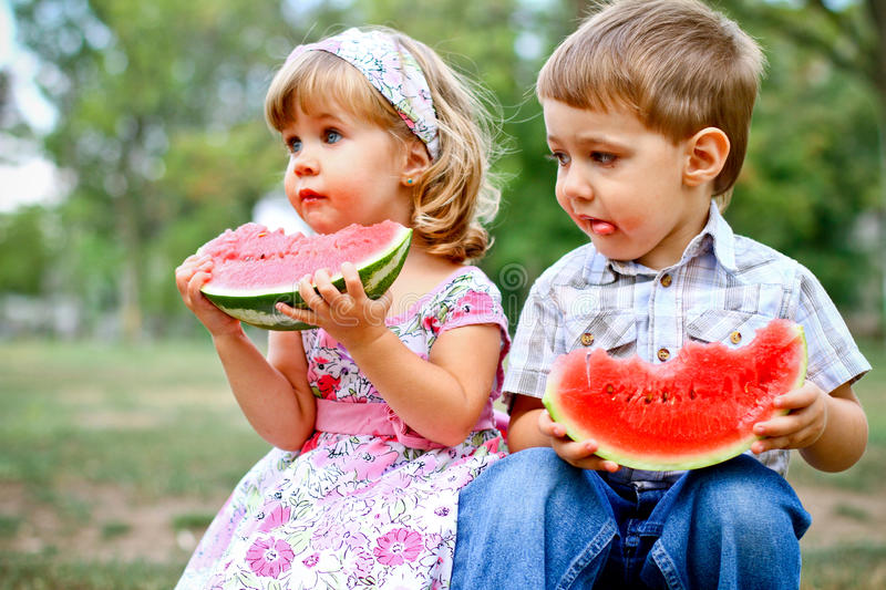 Download Two Pretty Kids With Watermelon Stock Photo - Image of happy, family: 26535628