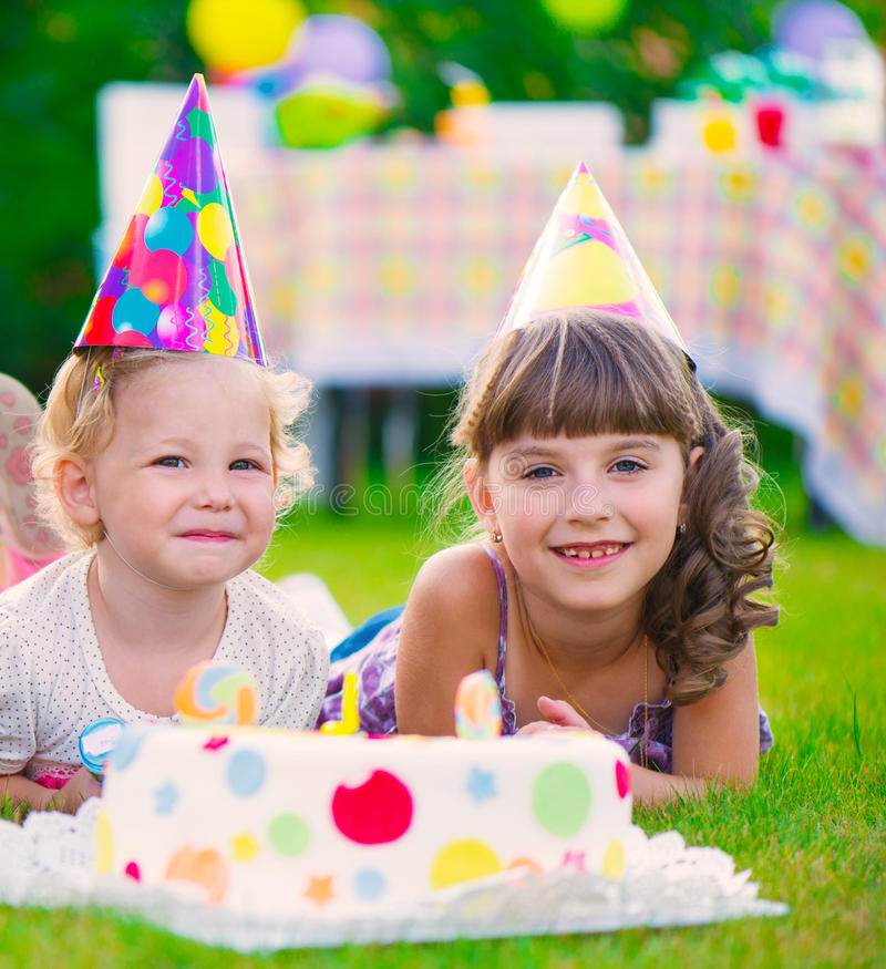Two pretty little girls celebrating birthday royalty free stock photography