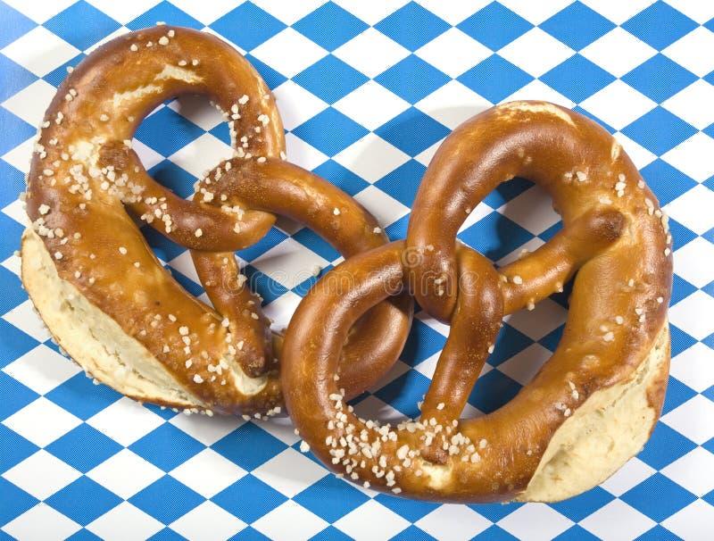 Two pretzels on bavarian flag royalty free stock image
