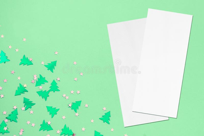 Two price-list or menu mockups on christmas mint background. Two empty price-list or menu mockups with soft shadows, lying diagonally on top of each other on royalty free stock photography