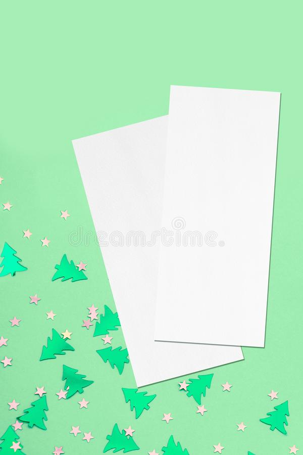 Two price-list or menu mockups on christmas mint background. Two empty price-list or menu mockups with soft shadows, lying diagonally on top of each other on stock photos