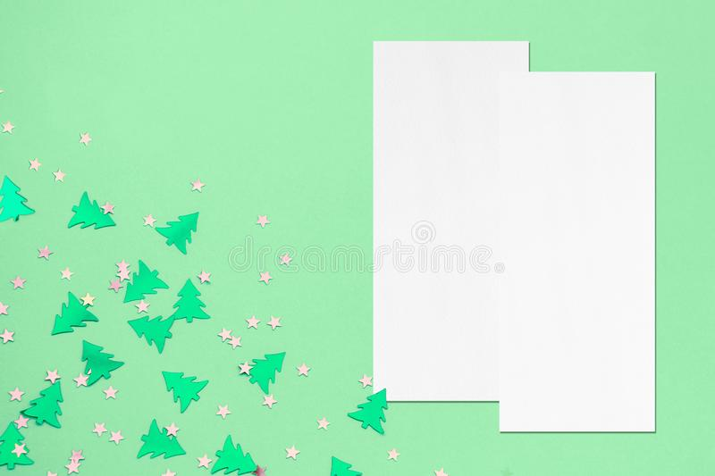 Two price-list or menu mockups on christmas mint background. Two empty price-list or menu mockups with soft shadows lying on top of each other on mint background royalty free stock photography