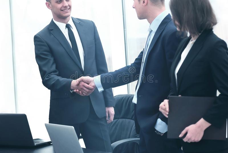 Professional business people shaking hands royalty free stock photography