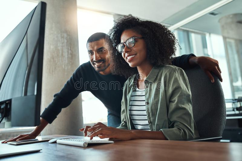 Two professional business people working together in office stock photography