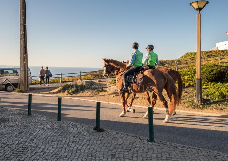 Two Public Safety Police Officers on Horses at Cabo da Roca (Cape Roca) . Portugal royalty free stock photography