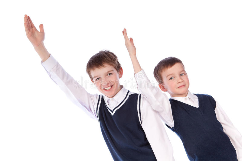 Download Two Pupils Raise Their Hands Up Stock Photo - Image: 18874128
