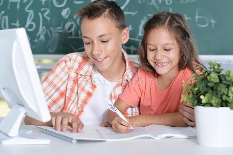 Two pupils working together. In computer class stock photos