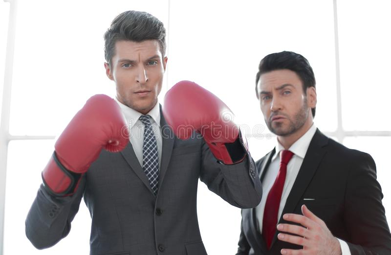 Two purposeful businessmen are in the office. The concept of business competition stock photos