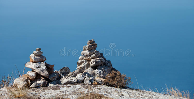 Two pyramids of stones stock photo