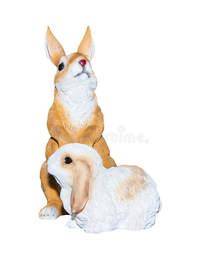 Two rabbits dolly toy is standing isolated on a white background royalty free stock image