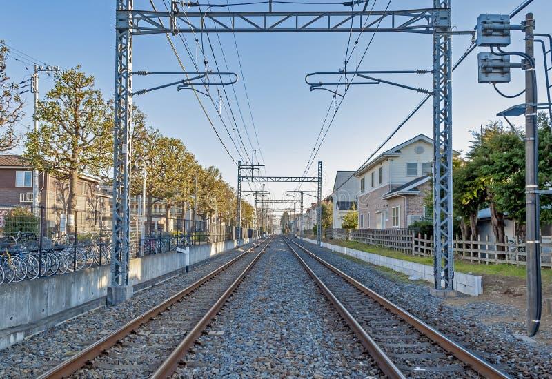 Two railways in urban area in Japan. Two railways in urban area near Nagareyama city, Chiba, Japan royalty free stock image
