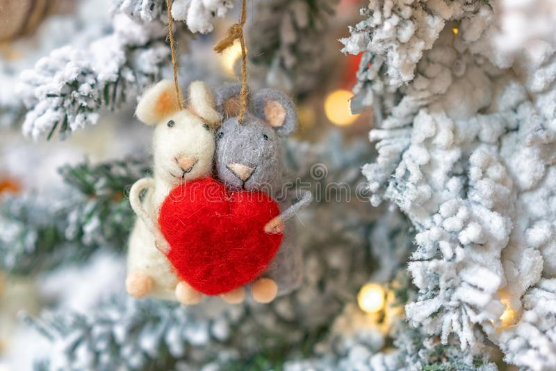 Two rats hanging on a Christmas tree, holiday decoration stock images