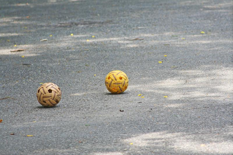 Two rattan ball on concrete floor. Close up Two rattan ball on concrete floor stock photography