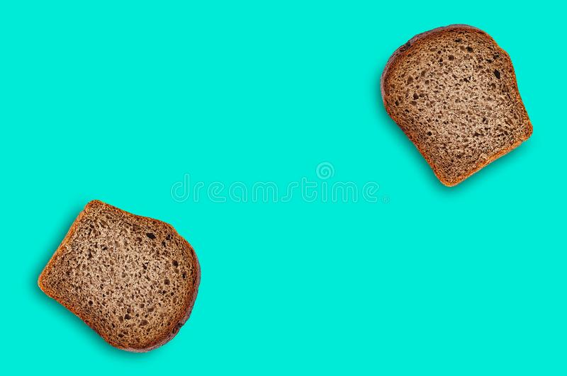 Two rectangular pieces of fresh rye bread on green table on kitchen. Copy space for your text. Top view. Dieting concept royalty free stock images